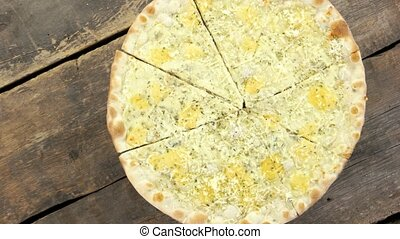 Four cheese pizza. Mozzarella, parmesan, ricotta and brie.