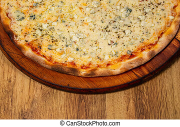four cheese pizza on wooden background