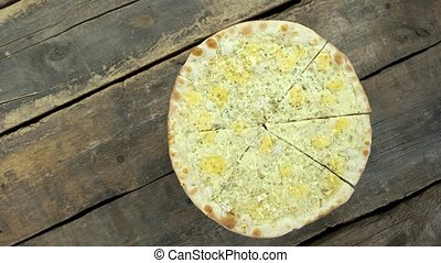 Four cheese pizza top view. Baked food on wooden background.