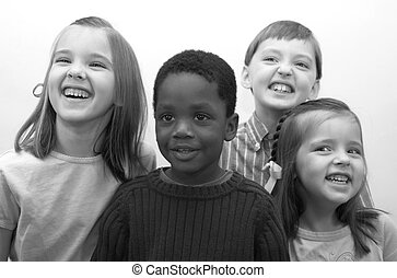 Four Children - Four beautiful children smiling for the...