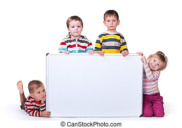 A group of four kids are holding a big white bord; isolated on the white background