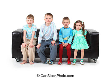 Four children sitting on black leather sofa