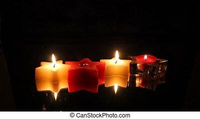 four Christmas star candles row