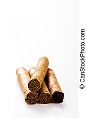 Four cigars on a white background