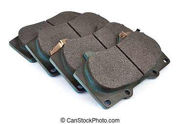 Four clean isolated disc brake pads. Isolate on white.
