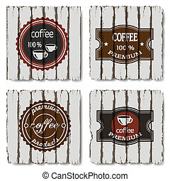 Four coffee labels on old wood background
