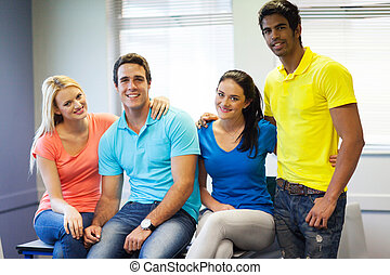 four college friends in classroom