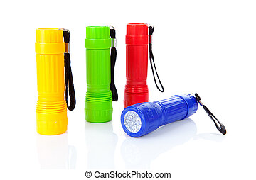 Four colorful flashlights in a row over white background