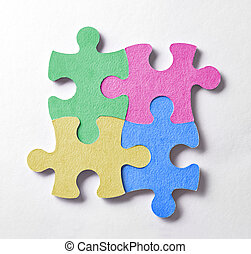 Four colorful puzzle pieces arranged in a square and bonded