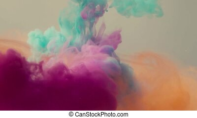 Four colors of ink dropped in water - Close up of four ...