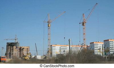 Four construction crane, excavator, truck. Working