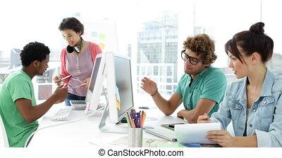 Four creative designer working together