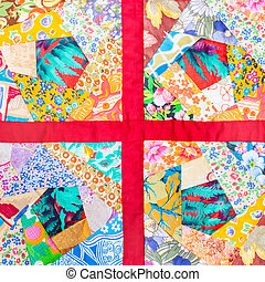 patchwork quilt framed in red cloth