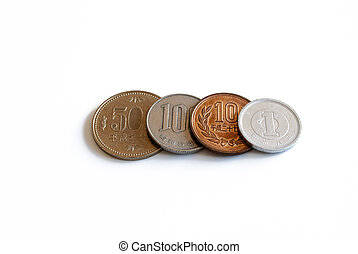 four different japanese coins in a row isolated on white background