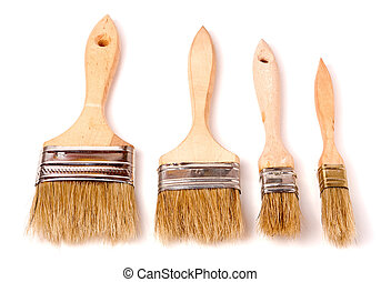 Four different size paint brushes isolated on white background