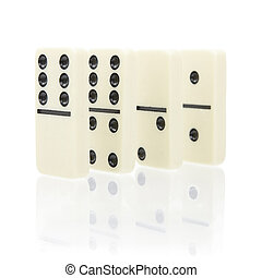 dominoes - Four dominoes stand on a white background