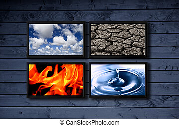 Four elements - Big panel of TV�s on a wood blue wall...