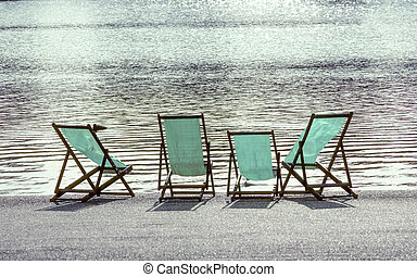 four empty deck chairs at the Hyde Park in London