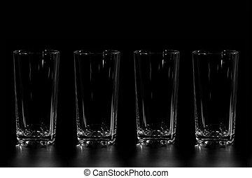 Four empty glass cups