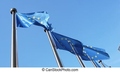 Four EU flags fluttering proudly in a celeste sky in Belgium...