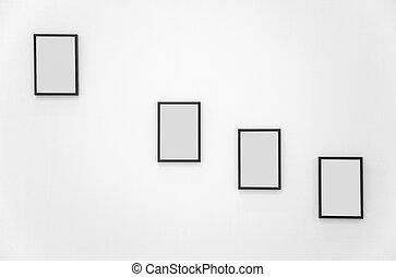 Four frames on white wall