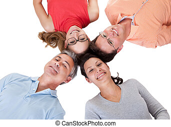 Four friends facing in with their heads together