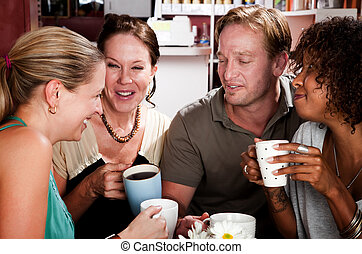 Diverse group of four friends in a coffee house