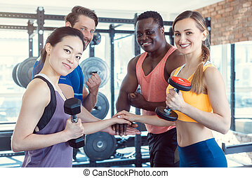 Four friends in the gym having fun