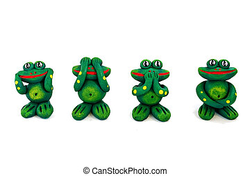 four frogs statues
