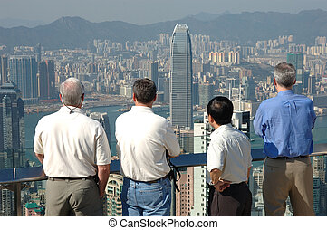 Four gentlemen looking at the commerical city of Hong Kong