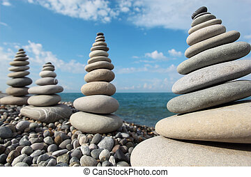 stone stacks against sky - four giant stone stacks against...