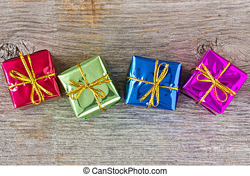 Four gifts on the wooden floor