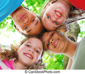 Four girls - Faces of four happy young girls shot from below