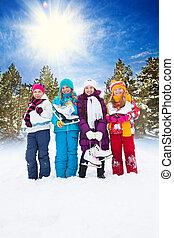 Four girls with ice skates
