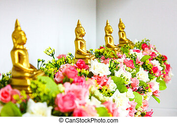 four gold buddha on the flower in the row.