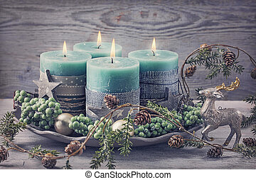 Four green christmas candle
