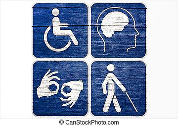 Four Grunge disabled symbols isolated on white