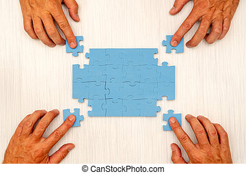 Four hands collects jigsaw puzzle