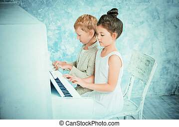 four hands - Romantic children playing the white piano....