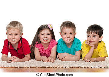 Four happy children on the white carpet