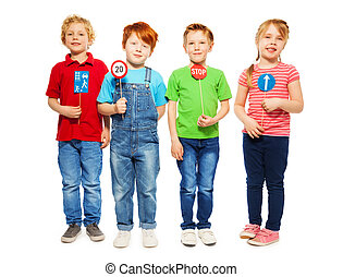 Four happy kids studying safety of traffic rules - Group of...