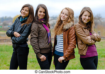 Four happy teenage friends - Four happy teenage girls...