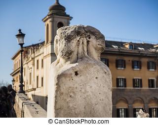 Four heads marble pillars the Ponte Fabricio Bridge in Rome...