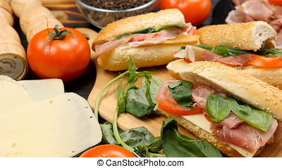 Four healthy and delicious sandwiches lying on wooden board...