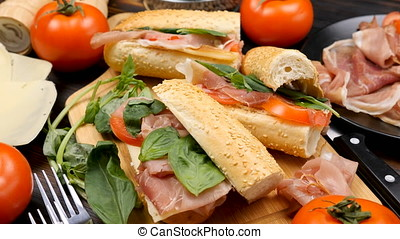 Four homemade delicious sandwiches on the table in kitchen...