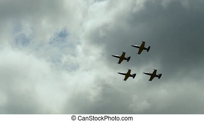 Four jets flying in formation