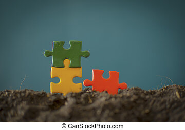 four jigsaw puzzle couple of pieces on wood texture background empty copy space for inscription or objects. business, education concept. red, green, blue, yellow, Orange
