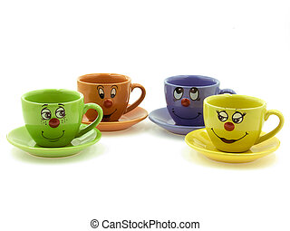 Four kid's cups with curious faces are standing on the saucers beside each other
