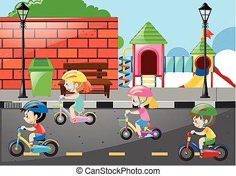 Four kids cycling on the road