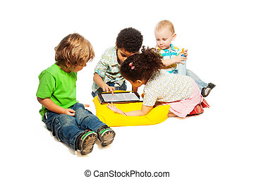 Four kids playing tablet computer